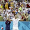 United States\' Omar Gonzalez celebrates after qualifying for the next World Cup round following their 1-0 loss to Germany during the group G World Cup soccer match between the USA and Germany at the Arena Pernambuco in Recife, Brazil, Thursday, June 26, 2014. (AP Photo/Ricardo Mazalan)