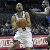 Photo - San Antonio Spurs guard Tony Parker (9), of France, goes to the hoop against Oklahoma City Thunder's Nazr Mohammed, right,  during the first half of an NBA basketball game on Saturday, Feb. 4, 2012, in San Anotnio. (AP Photo/San Antonio Express-News, Tom Reel)