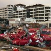 A destroyed helicopter lies on its side in the parking lot of the Joplin Regional Medical Center in Joplin, Mo., Sunday, May 22, 2011. A large tornado moved through much of the city, damaging the hospital and hundreds of homes and businesses. (AP Photo/Mark Schiefelbein) ORG XMIT: MOMS111