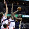 Utah Jazz\'s Al Jefferson (25) drives to the basket against Washington Wizards\' Jan Vesely, of the Czech Republic (24), Emeka Okafor (50) and A.J. Price (12) during the first half of an NBA basketball game, Saturday, Nov. 17, 2012, in Washington. (AP Photo/Nick Wass)