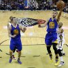 Golden State Warriors point guard Stephen Curry (30) drives to the basket past New Orleans Pelicans shooting guard Eric Gordon, right, during the second half of an NBA basketball game in New Orleans, Saturday, Jan. 18, 2014. The Warriors won 97-87. (AP Photo/Jonathan Bachman)
