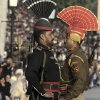 FILE -- In this Friday, Jan. 11, 2013 file photo, a Pakistani Ranger in black uniform and his Indian counterpart, march during a flag off ceremony, at the joint Pakistan-India border check post of Wagah near Lahore, Pakistan. Despite the worst violence in a nearly a decade along the disputed Kashmir border, tension has not spiraled out of control between Pakistan and India, showing just how far the archenemies have come since relations were shattered by the 2008 Mumbai terror attack. (AP Photo/K.M. Chaudary, File)