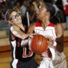 Norman\'s Sasha King (13), left, fouls Del City\'s Desiree Jeffries (32) during the girls high school basketball game between Del City and Norman in Del City, Okla., Tuesday, Dec. 4, 2007. Del City won, 60-52. By Nate Billings, The Oklahoman