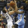 Photo - Memphis Grizzlies center Marc Gasol (33) of Spain, gets tangled with Denver Nuggets forward Kenneth Faried in the first half of an NBA basketball game Friday, April 4, 2014, in Memphis, Tenn. (AP Photo/Lance Murphey)