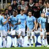 Photo - Manchester City's Alvaro Negredo, centre right, celebrates his goal with his teammates during their English League Cup soccer match against Newcastle United at St James' Park, Newcastle, England, Wednesday, Oct. 30, 2013. (AP Photo/Scott Heppell)