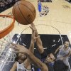 Dallas Mavericks\' Brandan Wright shoots as San Antonio Spurs\' Tim Duncan (21) defends during the first half of an NBA basketball game, Sunday, March 2, 2014, in San Antonio. (AP Photo/Eric Gay)