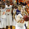 Oklahoma State\'s Marcus Smart (33), Michael Cobbins (20), Markel Brown (22), Brian Williams (4) and Kansas State\'s Angel Rodriguez watch as Oklahoma State\'s Phil Forte (13) takes a free throw in the second half of an NCAA college basketball game in Stillwater, Okla., Saturday, March 9, 2013. Oklahoma State won 76-70. (AP Photo/Sue Ogrocki) ORG XMIT: OKSO108