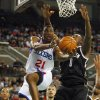 Philadelphia 76ers\' Thaddeus Young (21) goes up for a layup as Brooklyn Nets\' Andray Blatche (0) defends in the first half during a preseason NBA basketball game, Saturday, Oct. 13, 2012, in Atlantic City, N.J. (AP Photo/Rich Schultz)