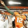 Photo - Miami quarterback Jacory Harris throws his sweatbands into the stands after Miami defeated Georgia Tech last Thursday. If OU can win in Miami on Oct. 3, the Sooners could be back in the national title discussion. AP PHOTO
