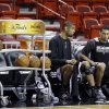 Photo - San Antonio Spurs shooting guard Danny Green, right, and power forward Tim Duncan chat as they prepare for NBA basketball practice, Wednesday, June 19, 2013, at the American Airlines Arena in Miami. The Spurs take on the Miami Heat in Game 7 of the NBA Finals on Thursday in Miami. (AP Photo/Wilfredo Lee)