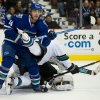 Vancouver Canucks\' Alex Burrows, left, checks San Jose Sharks\' Dan Boyle in front of goalie Antti Niemi, of Finland, during the first period of an NHL hockey game, Thursday, Nov. 14, 2013 in Vancouver, British Columbia. (AP Photo/The Canadian Press, Darryl Dyck)