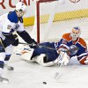 St. Louis Blues\' Patrik Berglund (21) is stopped by Edmonton Oilers goalie Ilya Bryzgalov (80) during second period NHL hockey action in Edmonton, Canada, Tuesday, Jan. 7, 2014. (AP Photo/The Canadian Press, Jason Franson)