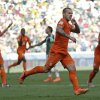 Netherlands\' Wesley Sneijder, center, celebrates after scoring his side\'s first goal during the World Cup round of 16 soccer match between the Netherlands and Mexico at the Arena Castelao in Fortaleza, Brazil, Sunday, June 29, 2014. (AP Photo/Natacha Pisarenko)