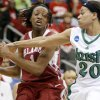 OU\'s Nyeshia Stevenson tries to pass the ball around Notre Dame\'s Ashley Barlow during the Sweet 16 round of the NCAA women\'s basketball tournament in Kansas City, Mo., on Sunday, March 28, 2010. Photo by Bryan Terry, The Oklahoman