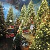 Christmas trees on display in a room called the