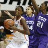 Oklahoma State\'s Toni Young (15) goes to the basket past TCU\'s Natalie Ventress (24) and Latricia Lovings (21) during a women\'s college basketball game between Oklahoma State University and TCU at Gallagher-Iba Arena in Stillwater, Okla., Tuesday, Feb. 5, 2013. Photo by Bryan Terry, The Oklahoman