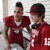 Photo - Kenny Stills poses for a photograph with Corey Cargill, 13, from Oklahoma City during the Meet the Sooners event inside Gaylord Family/Oklahoma Memorial Stadium at the University of Oklahoma on Saturday, Aug. 4, 2012, in Norman, Okla.  Photo by Steve Sisney, The Oklahoman