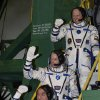 U.S. astronaut Steven Swanson, center, Russian cosmonauts Alexander Skvortsov, bottom, and Oleg Artemyev, crew members of the mission to the International Space Station (ISS) gesture prior the launch of Soyuz-FG rocket at the Russian leased Baikonur cosmodrome, Kazakhstan, Wednesday, March 26, 2014. (AP Photo/Vasily Maximov, Pool)
