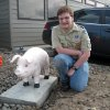 "Photo - This undated photo supplied by the Astoria Police Department shows Michael Peden, 16, an Eagle Scout candidate, with a concrete pig he helped restore for the police department in Astoria, Ore. The pig was dropped off in 1993 by someone whose motive wasn't clear and two decades have taken their toll, washing off the pink paint, pitting the surface and loosening the ears.  Now, the department has stationed the restored pig in a more prominent location, as it said in a press release, ""at the entrance to the Police Department parking area, watching the comings and goings of police officers."" (AP Photo/Astoria Police Department)"