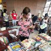 Lynn Swindall, Okla. City, looking through a pile of children\'s books at the Downtown Transit Center for Metro Transit in Oklahoma City Friday, Aug, 12, 2011. For the third year, Junior League of Oklahoma City and Bank of Oklahoma have teamed with METRO Transit to distribute free children\'s books to their riders and the community. Photo by Paul B. Southerland, The Oklahoman