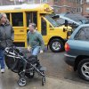 Peter Curry, center, unloads his daughter\'s wheel chair from his car after driving her to Public School 33, Wednesday, Jan. 16, 2013 in New York. She would normally be driven by school bus, according to her father. More than 8,000 New York City school bus drivers and aides went on strike over job protection Wednesday morning, leaving some 152,000 students, many disabled, trying to find other ways to get to school. (AP Photo/Mark Lennihan)