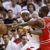 Miami Heat\'s LeBron James, left, drives up against Chicago Bulls\' Ronnie Brewer during the first half of Game 4 of the NBA Eastern Conference finals basketball series in Miami, Tuesday, May 24, 2011. (AP Photo/Wilfredo Lee) ORG XMIT: AAA115