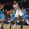 Photo - Oklahoma City's Russell Westbrook (0) tries to gain control of th ball between New Orleans' David West (30), New Orleans' Jason Smith (14), and New Orleans' Willie Green (33) during the NBA basketball game between the Oklahoma City Thunder and the New Orleans Hornets, Wednesday, Feb. 2, 2011 at the Oklahoma City Arena. Photo by Bryan Terry, The Oklahoman