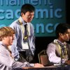 Team Oklahoma competitors Hunter Antonisse, left, Yifan Song, center, and Steven Kappen, right, prepare to be introduced before the National Finals game June 17 at the National Tournament of Academic Excellence in Orlando. Photos by David Brame, Dynamx Digital Dynamx Digital - Photos by David Brame, Dynamx Digital.
