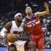 Washington Wizards\' Otto Porter (22) forces Miami Heat\'s LeBron James (6) to pass the ball during the first half of an NBA basketball game, Monday, March 10, 2014, in Miami. (AP Photo/J Pat Carter)