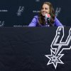 WNBA star Becky Hammon takes questions from the media at the San Antonio Spurs practice facility after being introduced as an assistant coach with the team on Tuesday, Aug. 5, 2014 in San Antonio. The San Antonio Spurs hired WNBA star Becky Hammon on Tuesday, making her the first full-time, paid female assistant on an NBA coaching staff. (AP Photo/Bahram Mark Sobhani)