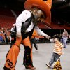 MASCOTS: Oklahoma State University mascot Pistol Pete has fun with Jaxton Bobik, 2, of Stillwater, son of Oklahoma State basketball player Daniel Bobik at the pep rally at the Cox Convention center prior to OSU playing Southeastern Louisiana in the first round of the NCAA Tournament at the Ford Center in Oklahoma City, Friday, March 18, 2005. By Bryan Terry/The Oklahoman.