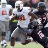 Oklahoma State\'s Justin Blackmon (81) tries to get by Texas Tech\'s Cody Davis (16) during a college football game between Texas Tech University (TTU) and Oklahoma State University (OSU) at Jones AT&T Stadium in Lubbock, Texas, Saturday, Nov. 12, 2011. Photo by Sarah Phipps, The Oklahoman ORG XMIT: KOD