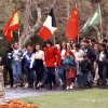 Photo - FILE - In this April 18, 1995 file photo, pop star Michael Jackson and Lisa Marie Presley walk with children that were invited guests at his Neverland Ranch home, in Santa Ynez, Calif. Jackson's playtime palace sits empty now. The backyard circus and laughter of children are long gone, but the house and its fanciful memories live on. (AP Photo/Mark J. Terrill, file)