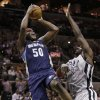 Memphis Grizzlies\' Zach Randolph (50) shoots over San Antonio Spurs\' DeJuan Blair during the first quarter of an NBA basketball game, Saturday, Dec. 1, 2012, in San Antonio. (AP Photo/Eric Gay)