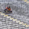 Fans sit in their seats at Lambeau Field before an NFL wild-card playoff football game between the Green Bay Packers and the San Francisco 49ers, Sunday, Jan. 5, 2014, in Green Bay, Wis. (AP Photo/Mike Roemer)