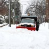 A plow clears snow along 2nd Street NE at Market Street after a snow fall on Thursday morning, Feb. 13, 2014, in Charlottesville, Va. (AP Photo/The Daily Progress, Ryan M. Kelly)