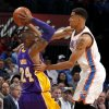 Oklahoma City\'s Thabo Sefolosha (2) defends Los Angeles\' Kobe Bryant (24) during an NBA basketball game between the Oklahoma City Thunder and the Los Angeles Lakers at Chesapeake Energy Arena in Oklahoma City, Tuesday, March. 5, 2013. Photo by Bryan Terry, The Oklahoman