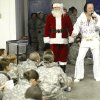 Santa and Elvis entertain soldiers from Ft. Sill as they wait for flights home for the holidays at the YMCA Military Welcome Center at Will Rogers World Airport, Saturday, Dec. 18, 2010, in Oklahoma City. Photo by Sarah Phipps, The Oklahoman