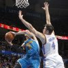 Oklahoma City Thunder\'s Nick Collison (4) defends on New Orleans Hornets\' Austin Rivers (25) during the NBA basketball game between the Oklahoma CIty Thunder and the New Orleans Hornets at the Chesapeake Energy Arena on Wednesday, Dec. 12, 2012, in Oklahoma City, Okla. Photo by Chris Landsberger, The Oklahoman