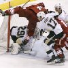 Photo - Phoenix Coyotes' Connor Murphy (5) collides with Pittsburgh Penguins goaltender Marc-Andre Fleury (29) as Penguins' Taylor Pyatt (17) and Brooks Orpik, second from right, chase down the puck ahead of Coyotes' Jeff Halpern (14) and Kyle Chipchura (24) during the second period of an NHL hockey game on Saturday, Feb. 1, 2014, in Glendale, Ariz. (AP Photo/Ralph Freso)