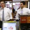 Republican presidential candidate, former Massachusetts Gov. Mitt Romney, left, talks on the phone with the store supervisor as he and his vice presidential running mate, Rep. Paul Ryan, R-Wis., make an unscheduled stop at a Wendy\'s restaurant in Richmond Heights, Ohio, on Election Day, Tuesday, Nov. 6, 2012. (AP Photo/Charles Dharapak)