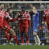 Photo - Queens Park Rangers' Shaun Wright-Phillips, center, reacts to his goal against Chelsea with teammates during their English Premier League soccer match at Stamford Bridge, London, Wednesday, Jan. 2, 2013. (AP Photo/Sang Tan)