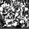 University of Oklahoma quarterback J.C. Watts eludes Texas right tackle Steve Massey (84) and makes the pitchout during game action in Dallas. The Texas Longhorns downed the Sooners, 20-13. Staff photo by Jim Argo taken 10/11/80.