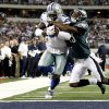 Dallas Cowboys wide receiver Dez Bryant (88) scores a touchdown as Philadelphia Eagles cornerback Dominique Rodgers-Cromartie (23) defends during the second half of an NFL football game, Sunday, Dec. 2, 2012, in Arlington, Texas. (AP Photo/Tony Gutierrez)