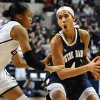Photo - Notre Dame's Skylar Diggins, right, is guarded by Connecticut's Moriah Jefferson, left, during the first half of an NCAA college basketball game in Storrs, Conn., Saturday, Jan. 5, 2013. (AP Photo/Jessica Hill)