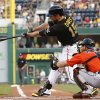 Photo - Pittsburgh Pirates' Ike Davis (15) drives in two runs with a bases-loaded double off Miami Marlins starting pitcher Tom Koehler during the first inning of a baseball game in Pittsburgh on Wednesday, Aug. 6, 2014. (AP Photo/Gene J. Puskar)