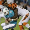 Photo - Miami Dolphins quarterback Ryan Tannehill (17) is sacked by Cincinnati Bengals defensive tackle Geno Atkins during the first half of an NFL football game, Thursday, Oct. 31, 2013, in Miami Gardens, Fla. (AP Photo/Wilfredo Lee)