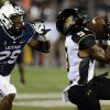 Photo - Towson wide receiver Leon Kinnard (9) catches the ball as Connecticut cornerback Taylor Mack (29), left, defends during the second half of an NCAA college football game at Rentschler Field in East Hartford, Conn., Thursday, Aug. 29, 2013. (AP Photo/Jessica Hill)