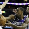 Photo - Sacramento Kings guard Tyreke Evans, center, is pressured by Memphis Grizzlies center Marc Gasol, of Spain, left, and Mike Conley (11) during the first half of an NBA basketball game in Memphis, Tenn., Tuesday, Feb. 12, 2013. (AP Photo/Danny Johnston)