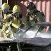 Firefighters put out a car fire during live fire drills for fire department recruit training at the Eastern Oklahoma County Vo-Tech in Choctaw, OK, Monday, Jan. 30, 2012. By Paul Hellstern, The Oklahoman
